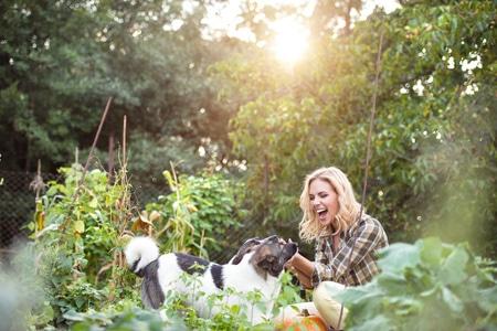 Woman Enjoying Gardening with her Dog